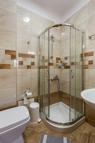 stratos apartments and studios shower area
